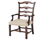 A hand carved Chippendale children's open armchair