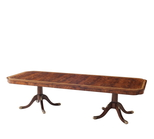 A mahogany and brass inlaid twin pedestal dining table
